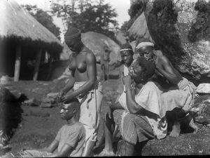 Yagala, Sierra Leone. Plaiting hair.