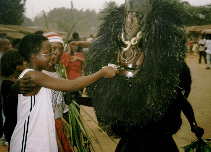 Chiadikobi Nwaubani and Ekpo masquerade in Umuahia, Nigeria.
