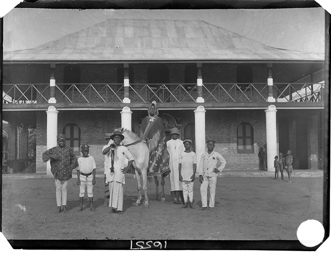 Chief Iyamu, photographed by N. W. Thomas in front of Egedege N'okaro, Benin City in 1909
