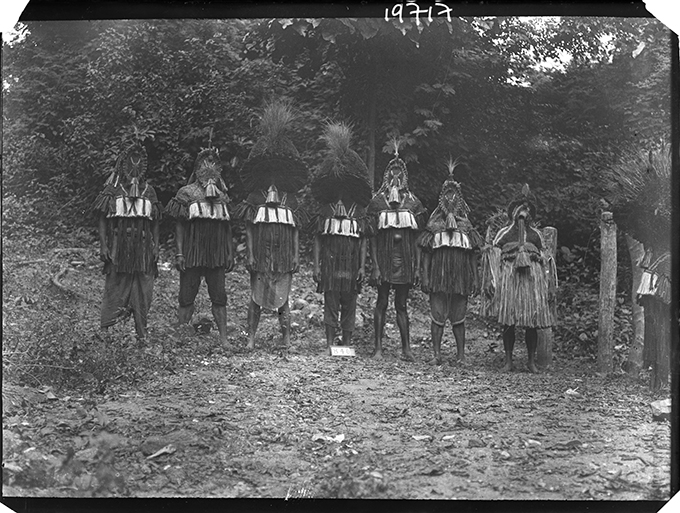 Northcote Thomas's photograph of the Eliminya masquerade costumes, Otuo, July 1909. NWT 840. RAI 400.19717.