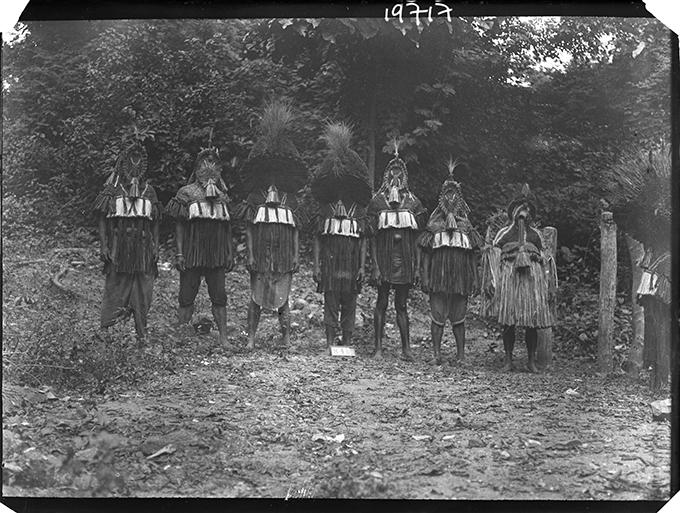Northcote Thomas's photograph of the Eliminya masquerade costumes, Otuo, July 1909. NWT 840. RAI 400.19717.