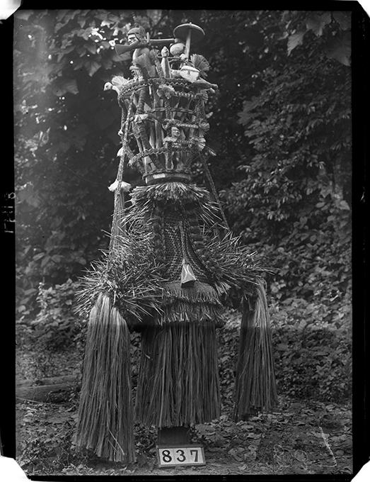 Eliminya Festival masquerade photographed by Northcote Thomas in Otuo in 1909