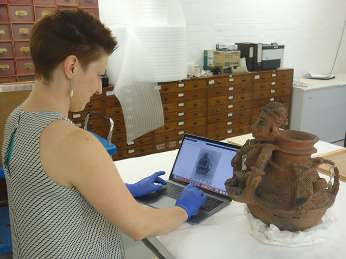 Object-based research at the Museum of Archaeology and Anthropology, University of Cambridge. Katrina Dring, Collections Assistant, documenting Olukun pot (Z 12112) collected by N. W. Thomas probably in Benin City, 1909.