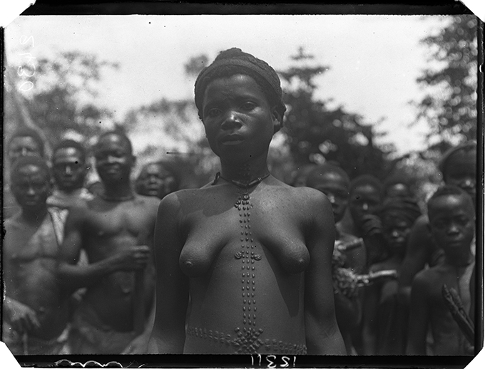 Woman with mbubu body marks, photographed by N. W. Thomas in Nri, 1911.