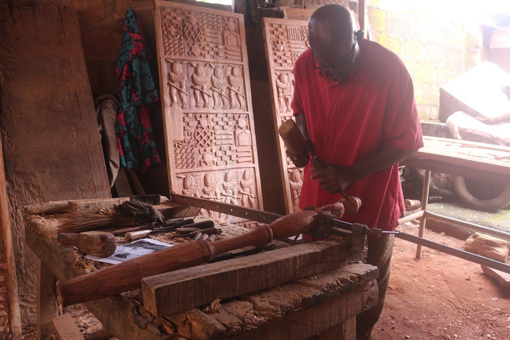 Felix Ekhator carving new commission of ukhure featuring Northcote Thomas, Benin City