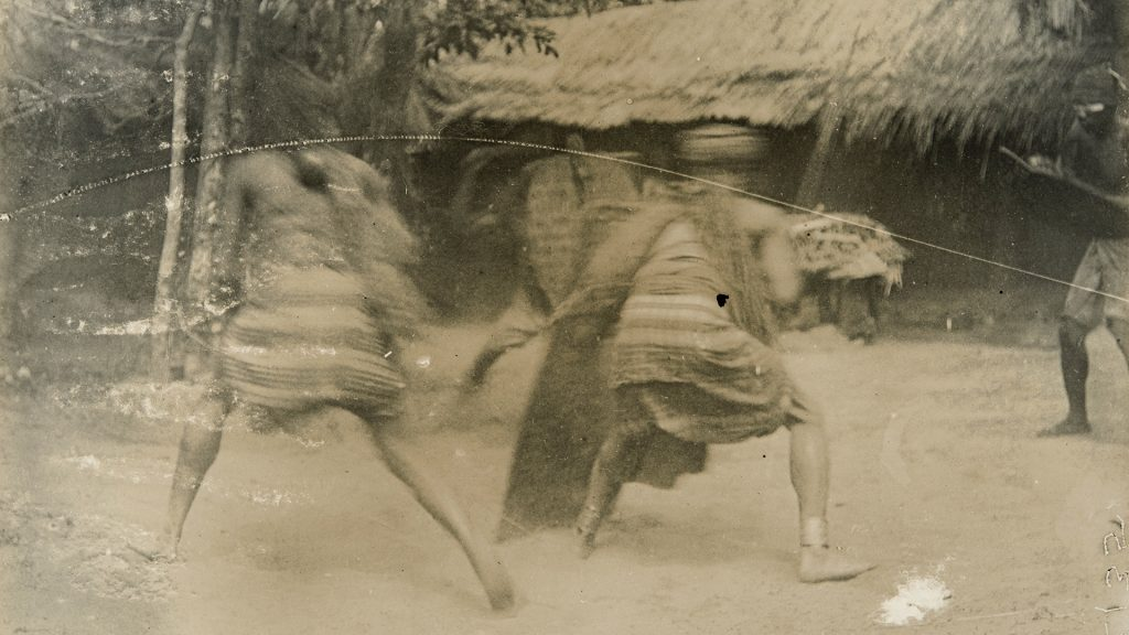 Men displaying fighting techniques, Awka. Photographed by Northcote Thomas in 1911.
