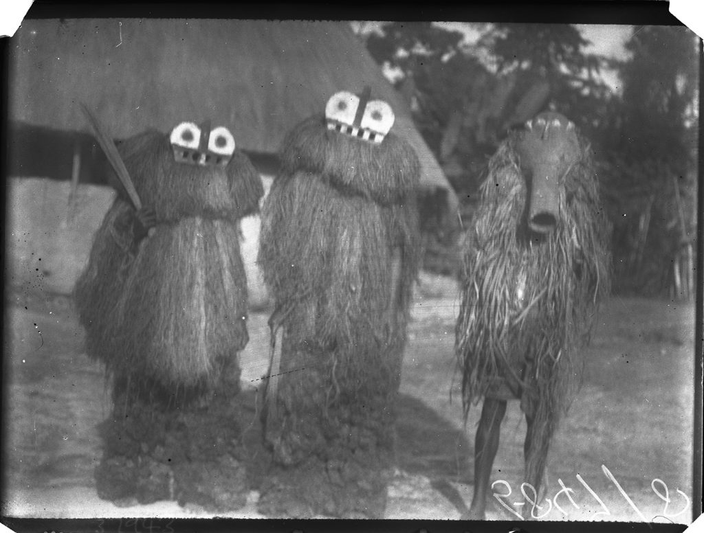 'Arong Athoma' and 'Namenkara' masquerades photographed by Northcote Thomas in Mamaka, Sierra Leone in 1914