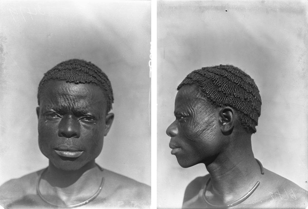 Physical type portrait of Nwobu, man with ichi scarification marks, photographed by Northcote Thomas in Amansi, Nigeria, 1911